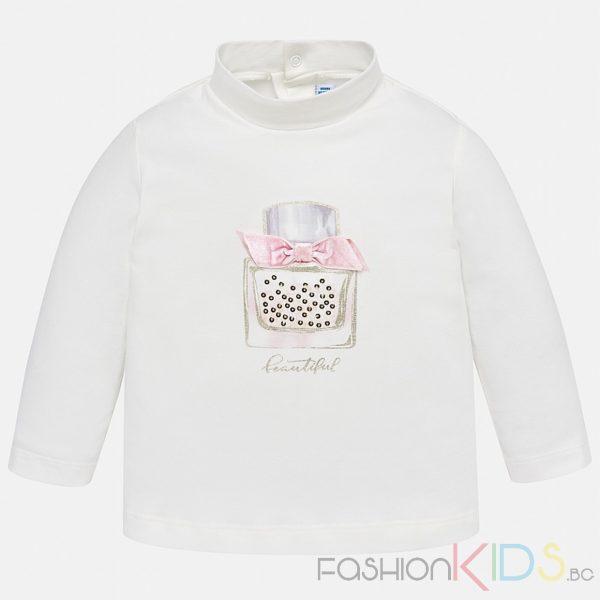 Бебешкаблуза с дълъг ръкав. Закопчаването е със скрити копчета на гърба за паа- лесно обличане. На гърдите има апликация с формата на луксозен парфюм, ситни камъни и релефна розова джуфка. Тъканта е мек, еластичен памук и печат върху предната част на тениската.