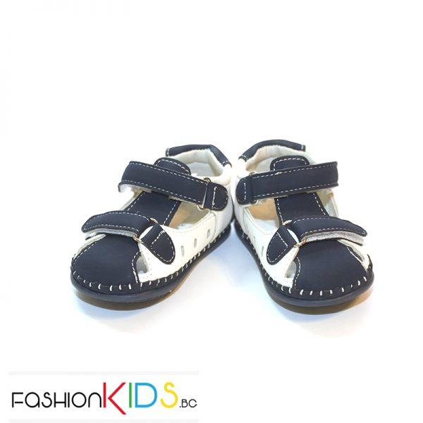 Бебешки сандали за момче за прохождане в тъмносиньо с бяло с две коригиращи лепки.