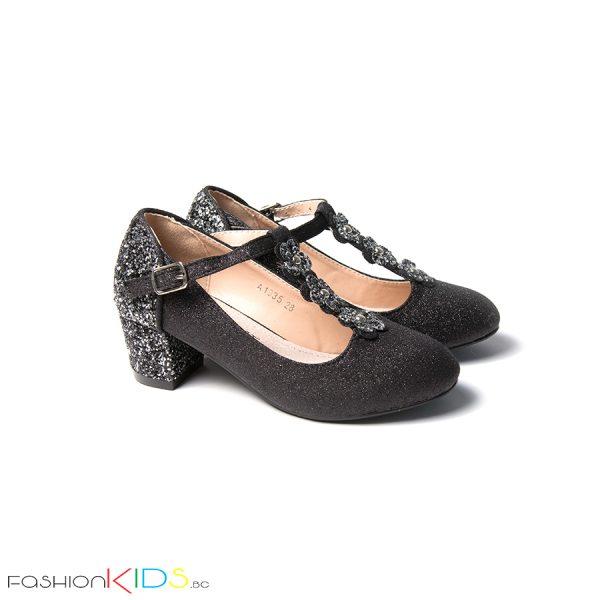 Детски официални обувки за момиче в черно с блестящ брокатен ток и коригираща каишка със същият ефект